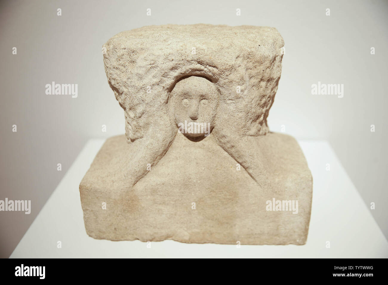 Head of a Woman by William Edmondson is on display at a press preview of an upcoming auction titled 'Outsider and Vernacular Art' at Christie's in New York City on January 12, 2019. The auction featuring Henry Darger's '148 At Jennie Richee During fury of storm are unsuccessfully attached (sic) by Glandelinians / 149 At Jennie Richee narrowly escape capture but Blengins come to rescue, double sided' , estd $250,000 - $500,000 and Bill Traylor's 'Goat, Camel, Lion and Figures', estd $75,000 - $100,000 takes place at Christie's on January 18th.     Photo by John Angelillo/UPI - Stock Image