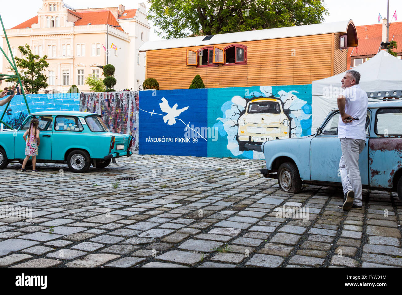 Street paintings, Trabant cars at outdoor exhibition in remembrance of  Pan-European Picnic 1989 - Stock Image