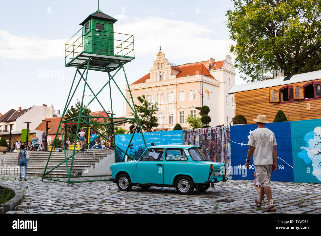 Street exhibition with Trabant car and border guard watchtower in remembrance of  Pan-European Picnic 1989 - Stock Image