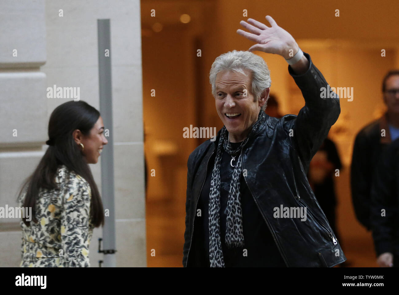 Don Felder waves when he arrives at a press preview for Play It Loud: Instruments of Rock & Roll at Metropolitan Museum of Art on April 1, 2019 in New York City. A groundbreaking exhibition presenting a spectacular array of iconic instruments of rock and roll will go on view at The Met on April 8. The exhibition includes Chuck Berry's electric guitar ES-350T (1957), which was used to record 'Johnny B. Goode'; a reconstructed performance rig from Eddie Van Halen as it appeared onstage in 1978; Lady Gaga's custom-designed piano; Stevie Ray Vaughan's composite stratocaster 'Number One'; Joan Jett - Stock Image