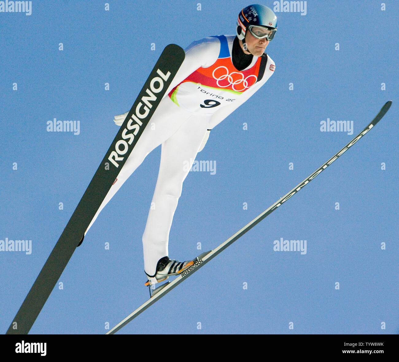 Alan Alborn of the USA soars during the training jump in the finals of men's large hill individual ski jumping at Pragelato in the 2006 Torino Winter Olympic Games, February 18, 2006. Alborn finishes 43rd overall. (UPI Photo/Heinz Ruckemann) - Stock Image