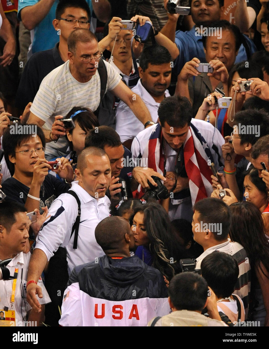 timeless design a0c1f ba32a Team USA's Kobe Bryant (in USA jersey) gets a kiss from his ...