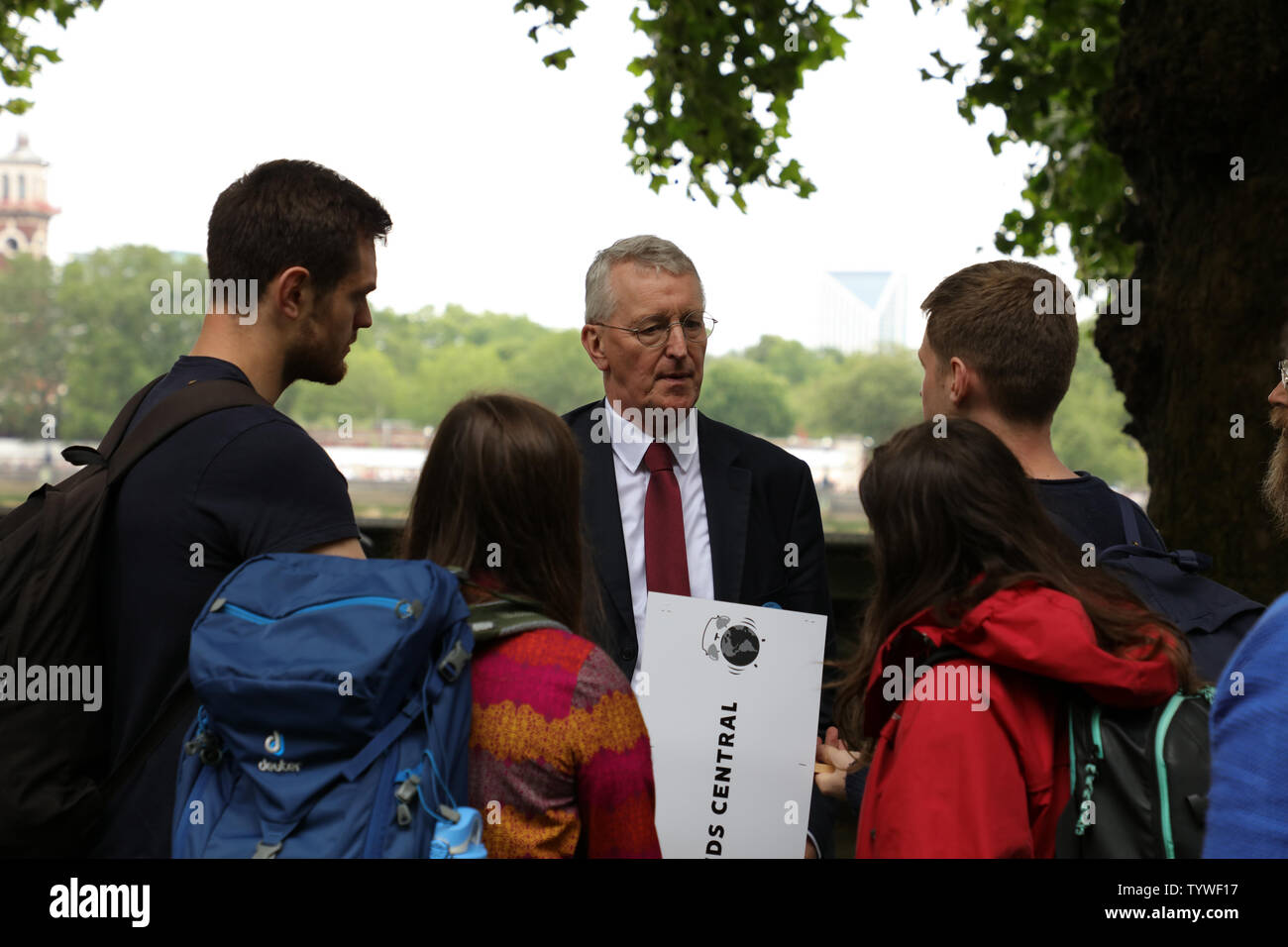 London, UK. 26th June 2019. British Member of Parliament Hilary Benn talking with participants of a mass lobby of MP's around the Houses of Parliament in London, organised by The Climate Coalition and Greener UK, pressing for more urgent and bold action on climate change. Credit: Joe Kuis / Alamy News - Stock Image