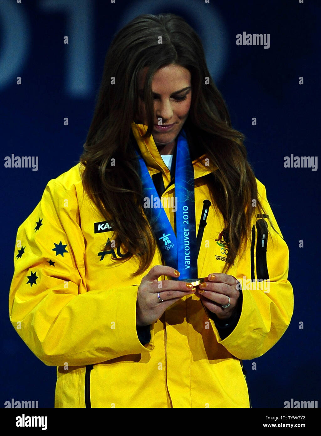 Torah Bright of Australia (gold) looks at the medal she earned for snowboard ladies' halfpipe at BC Place in Vancouver, Canada, during the 2010 Winter Olympics on February 19, 2010.     UPI/Roger L. Wollenberg - Stock Image