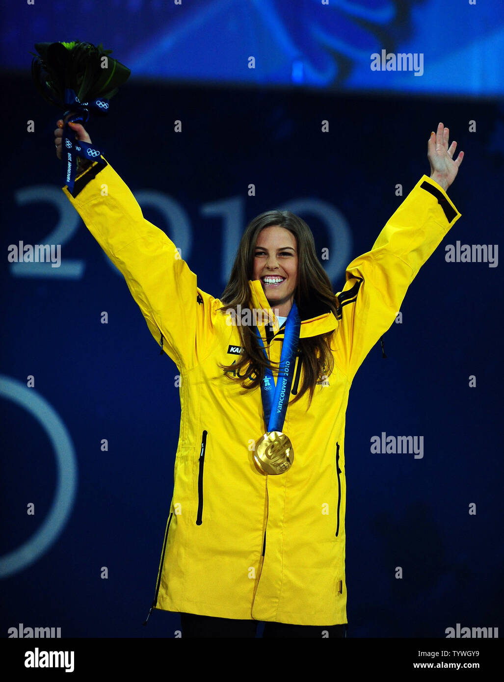 Torah Bright of Australia (gold) celebrates the medal she earned for snowboard ladies' halfpipe at BC Place in Vancouver, Canada, during the 2010 Winter Olympics on February 19, 2010.     UPI/Roger L. Wollenberg - Stock Image