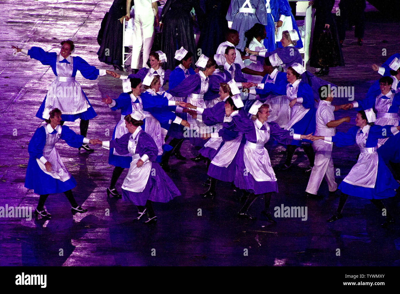 https://c8.alamy.com/comp/TYWMXY/performers-dressed-as-nurses-dance-in-celebration-of-the-british-national-health-service-nhs-during-the-opening-ceremony-at-the-london-2012-summer-olympic-games-on-july-27-2012-in-london-upiron-sachs-TYWMXY.jpg