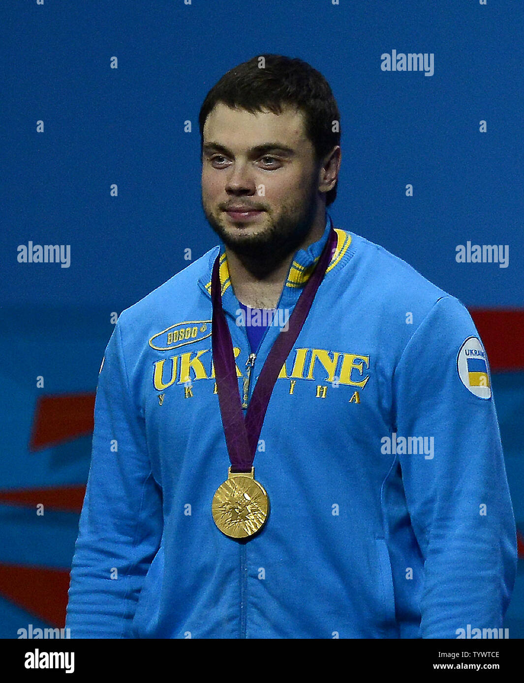 Oleksiy Torokhtiy of Ukraine wears the Gold Medal he earned in the Men's 105kg Weightlifting competition at the London 2012 Summer Olympics on August 5, 2012 in London.   UPI/Ron Sachs - Stock Image