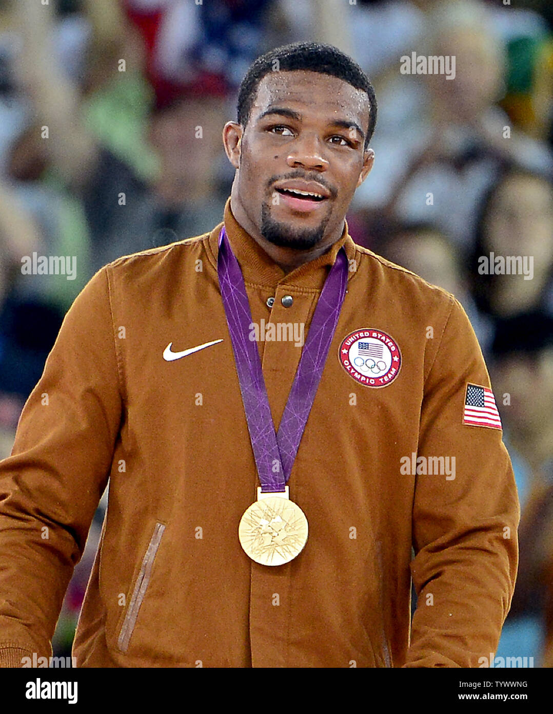 Jordan Ernest Burroughs of the United States of America wears the Gold Medal he earned in the Men's 74kg Freestyle Wrestling at the London 2012 Summer Olympics on August 10, 2012 in London.  UPI/Ron Sachs - Stock Image