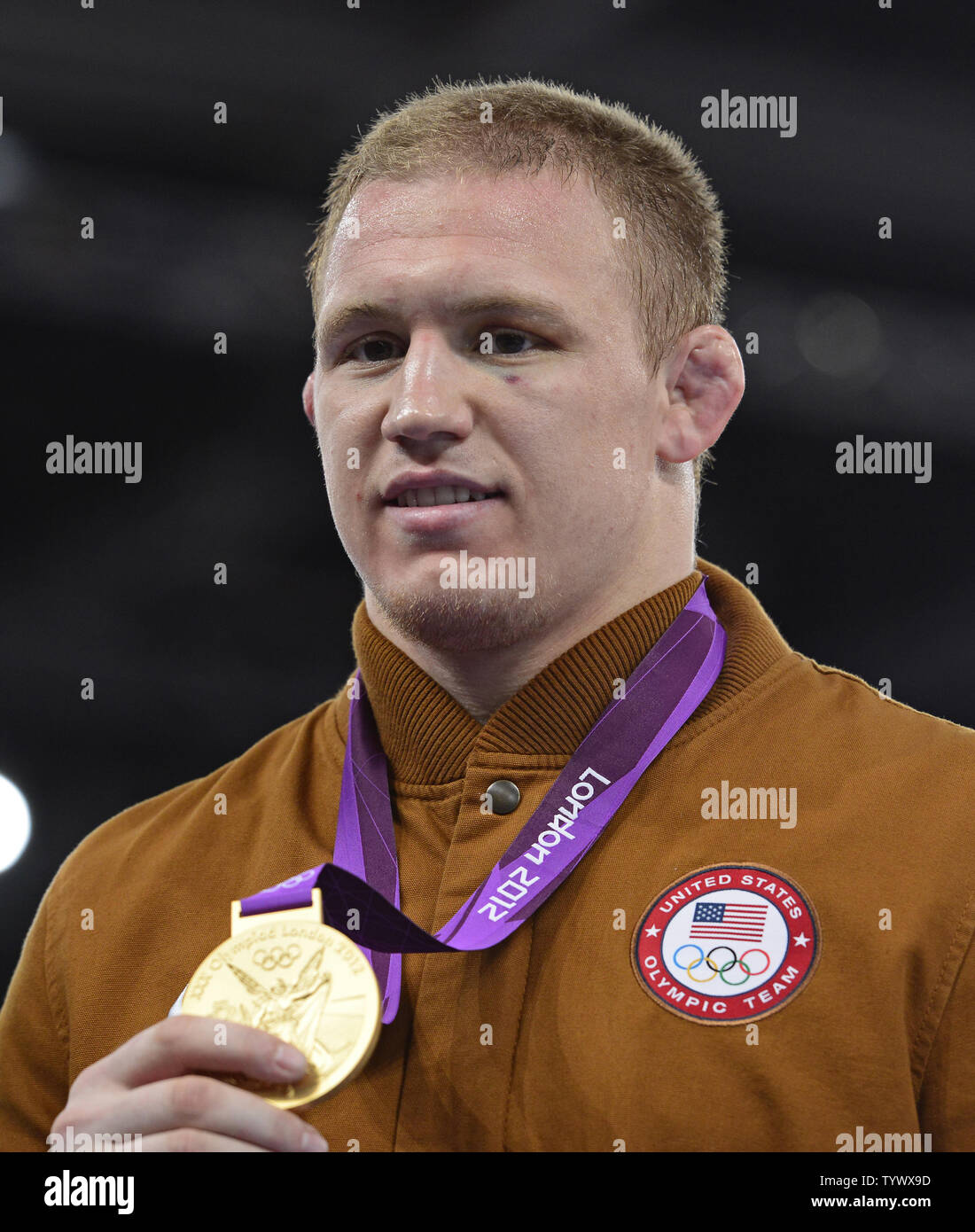 Jacob Stephen Varner of the United States of America shows off the Gold Medal he earned in the Men's 96kg Freestyle Wrestling at the London 2012 Summer Olympics on August 12, 2012 in London.   UPI/Ron Sachs - Stock Image