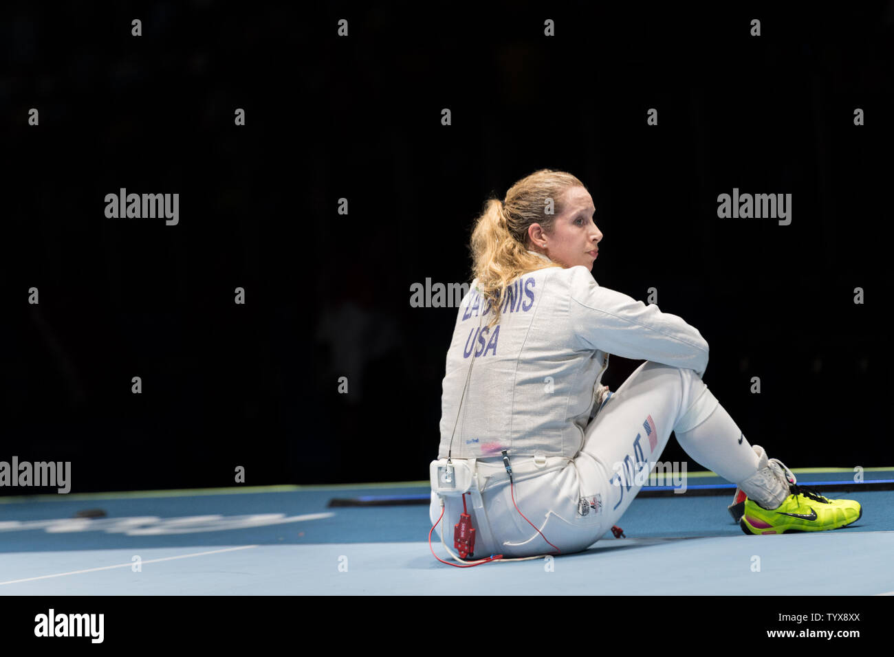 Fencer Mariel Zagunis of the United States sits down on the piste after losing to Russia in the Women's Team Saber semifinals at Carioca 3 Arena at the 2016 Rio Summer Olympics in Rio de Janeiro, Brazil, on August 13, 2016.  The United States lost 45-42 to Russia and will now compete with Italy for the bronze medal.      Photo by Richard Ellis/UPI.. Stock Photo