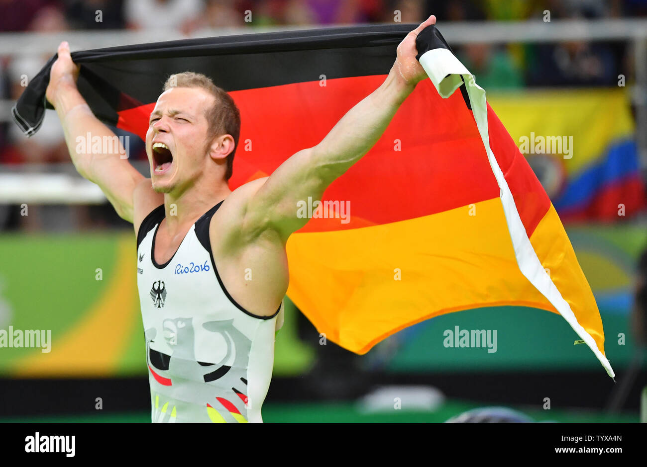 Fabian Hambuechen of Germany celebrates after competing and winning gold in the Horizontal Bar Final at the Olympic Arena of the 2016 Rio Summer Olympics in Rio de Janeiro, Brazil, August 16, 2016.          Photo by Kevin Dietsch/UPI - Stock Image
