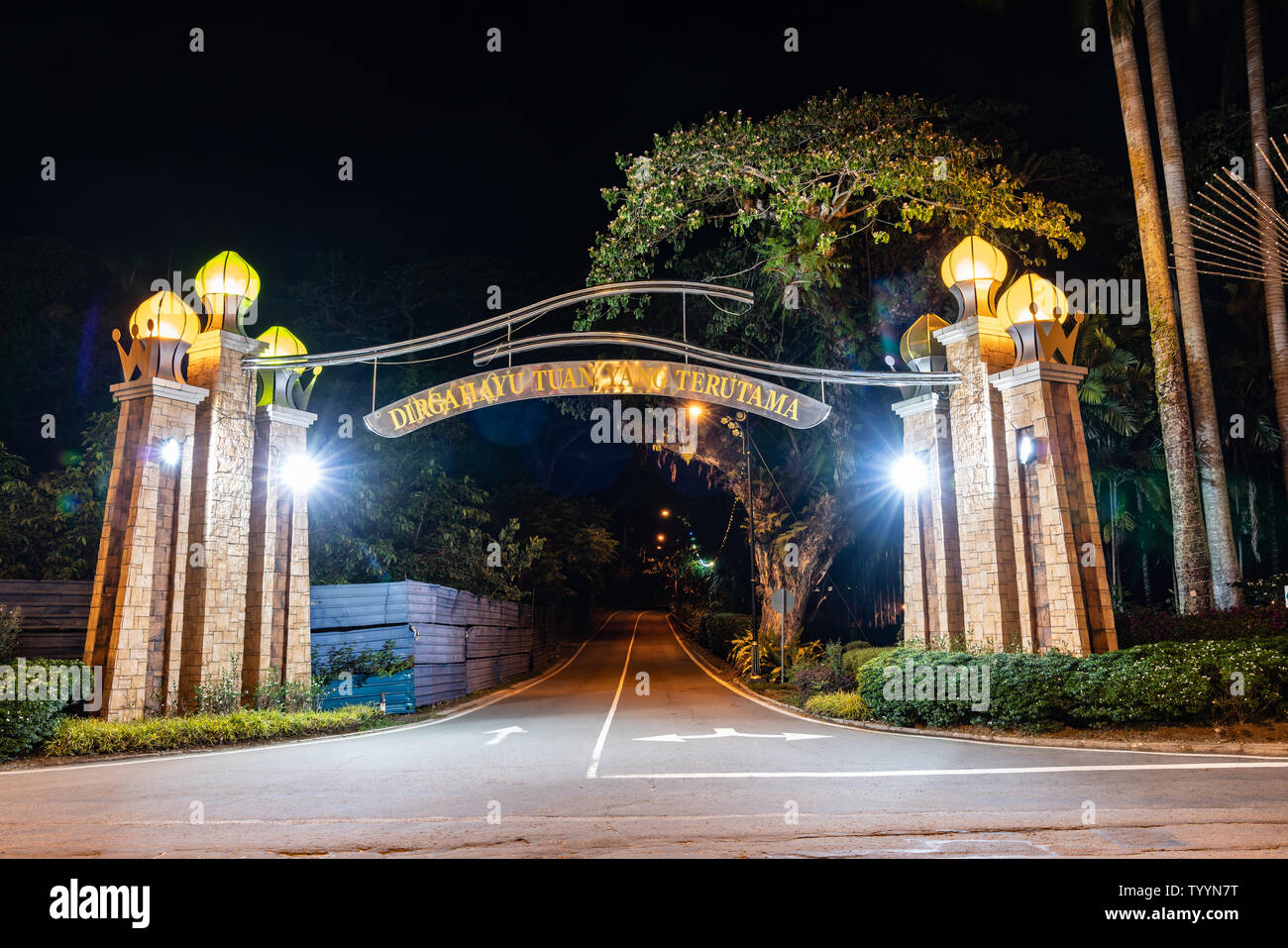 KOTA KINABALU BORNEO - MAY 30 2019; Entrance arch across street illuminated at night. - Stock Image