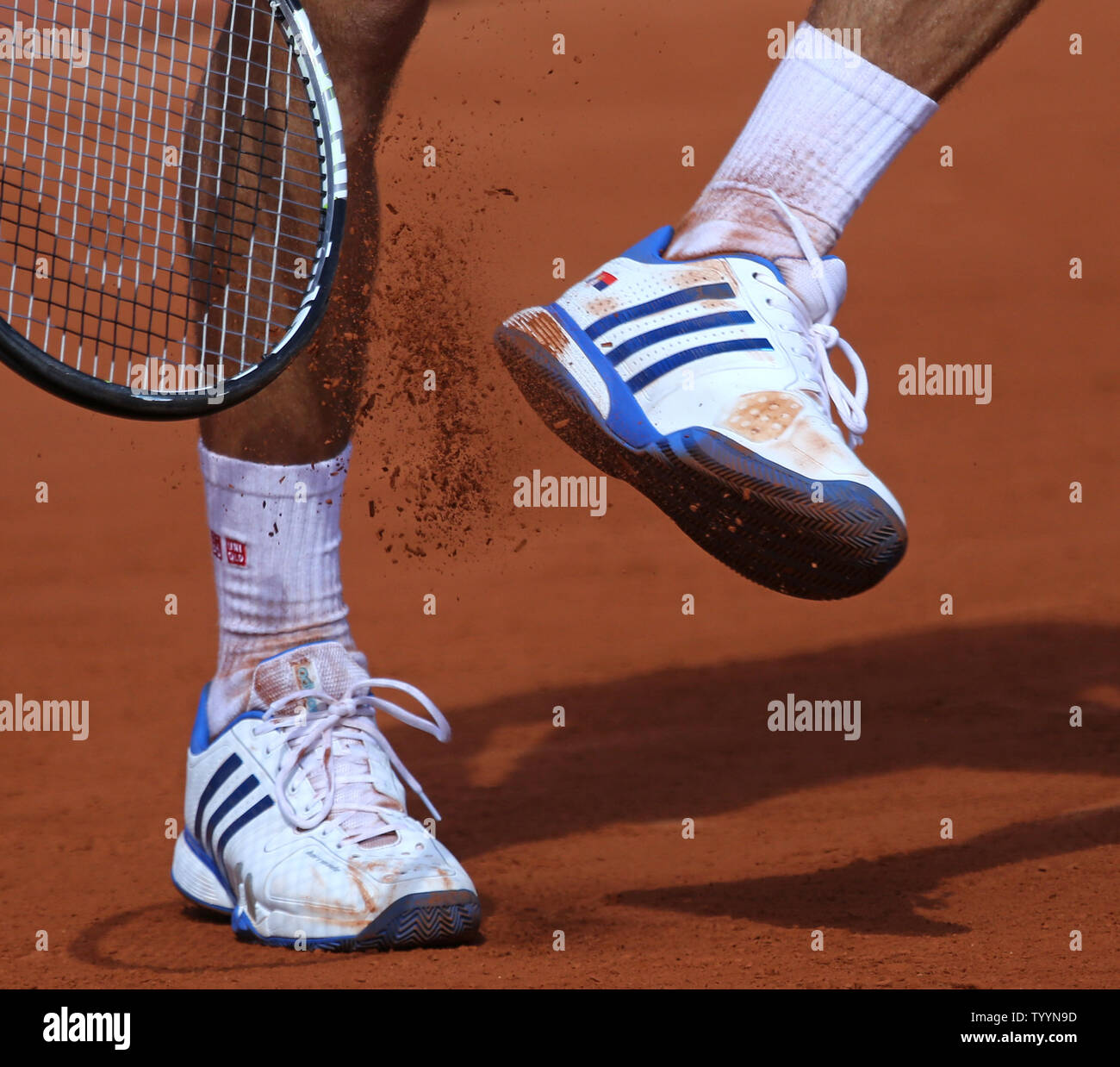 Novak Djokovic Of Serbia Clears The Clay From His Shoes During His French Open Men S Quarterfinal Match Against Rafael Nadal Of Spain At Roland Garros In Paris On June 3 2015 Djokovic
