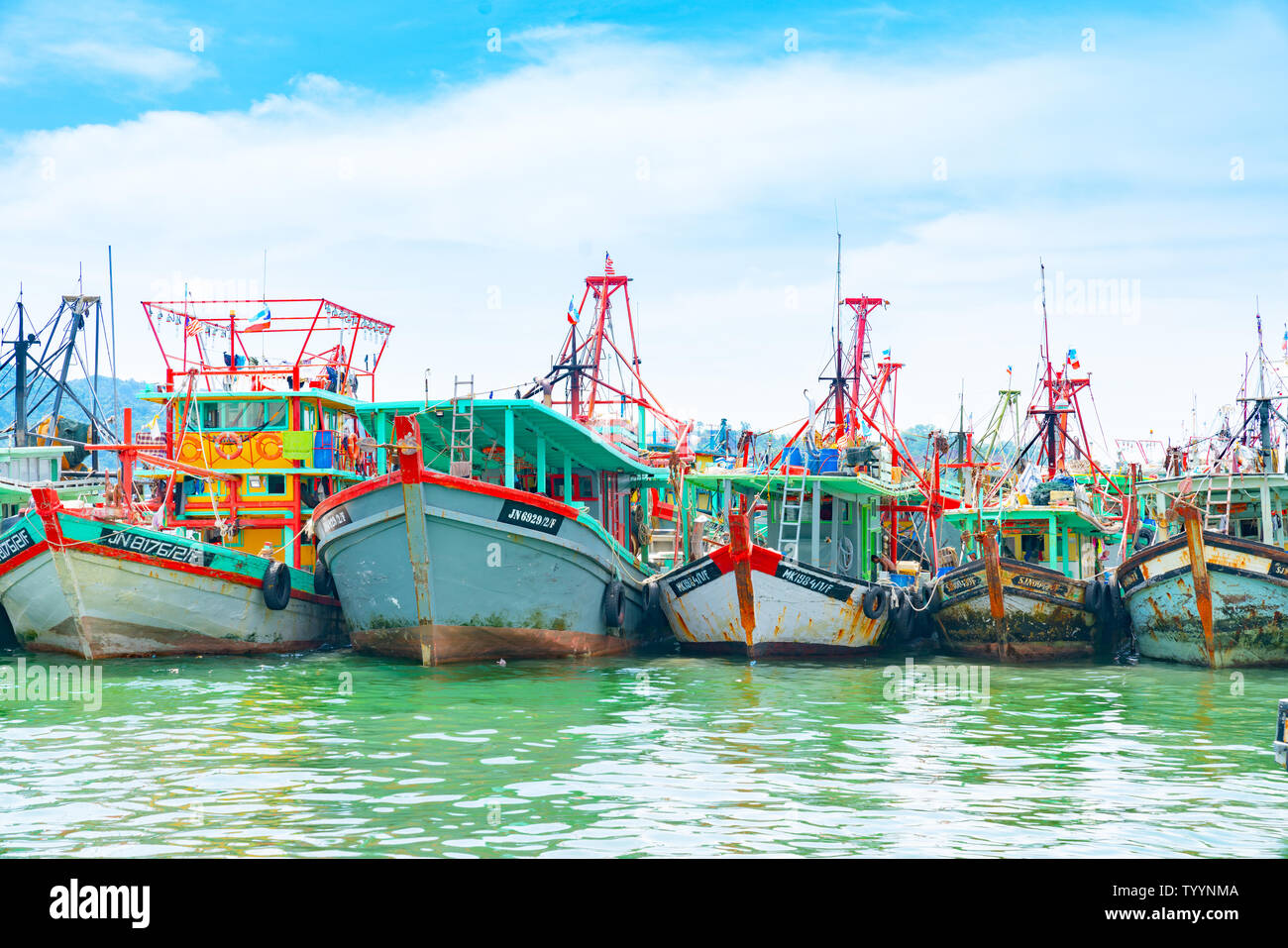KOTA KINABALU BORNEO - MAY 31 2019; City fishing fleet moored at docks ready to head out again to catch - Stock Image