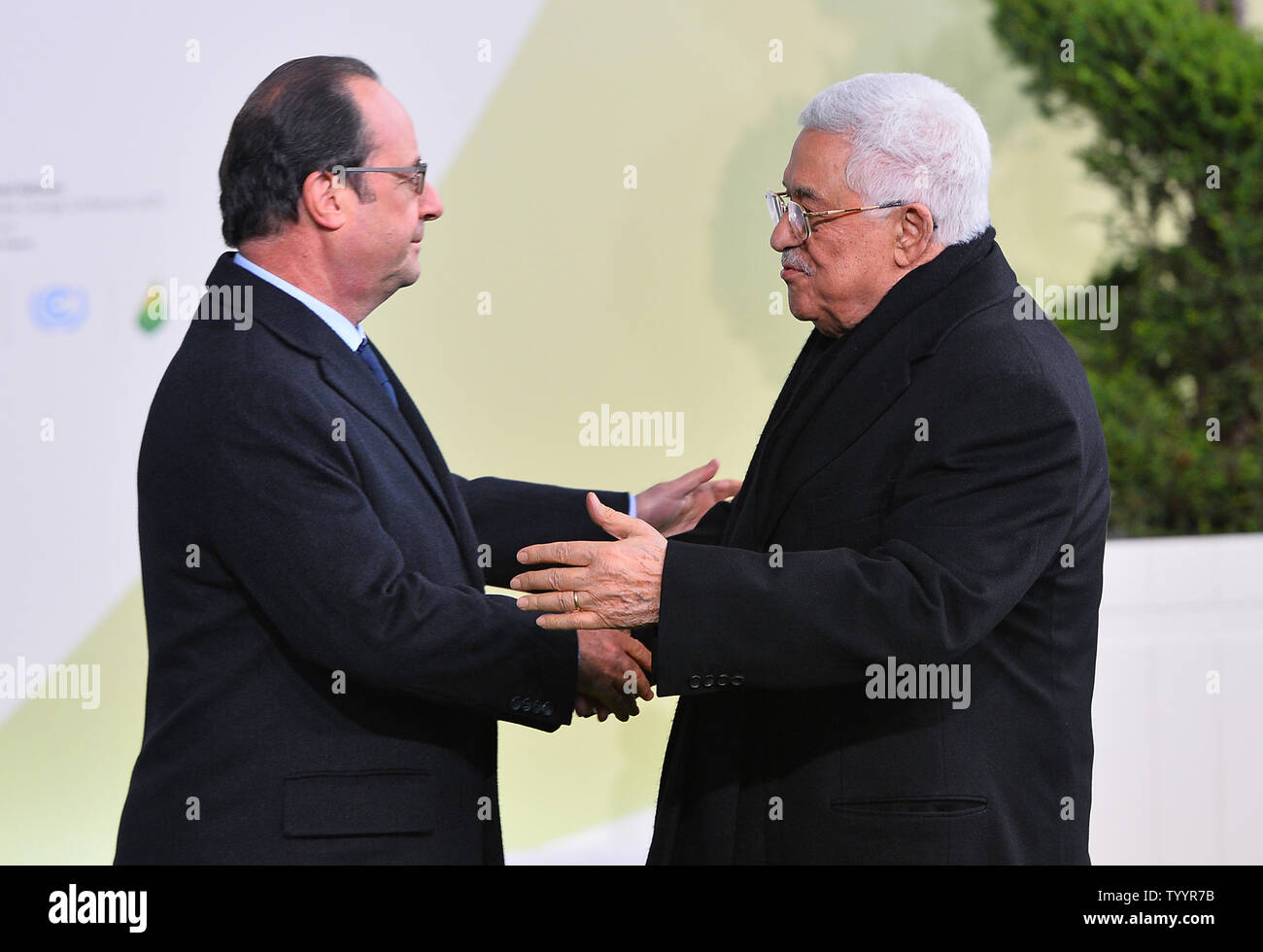 Palestinian President Mahmoud Abbas (R) is greeted by French President Francois Hollande at the United Nation's 21st climate change conference at Le Bourget near Paris on November 30, 2015. The almost 150 heads of state and representatives from 200 countries in attendance will attempt to negotiate a legally binding agreement to limit worldwide carbon emissions with the goal of keeping global warming under 2 degrees Celsius.   Photo by David Silpa/UPI - Stock Image