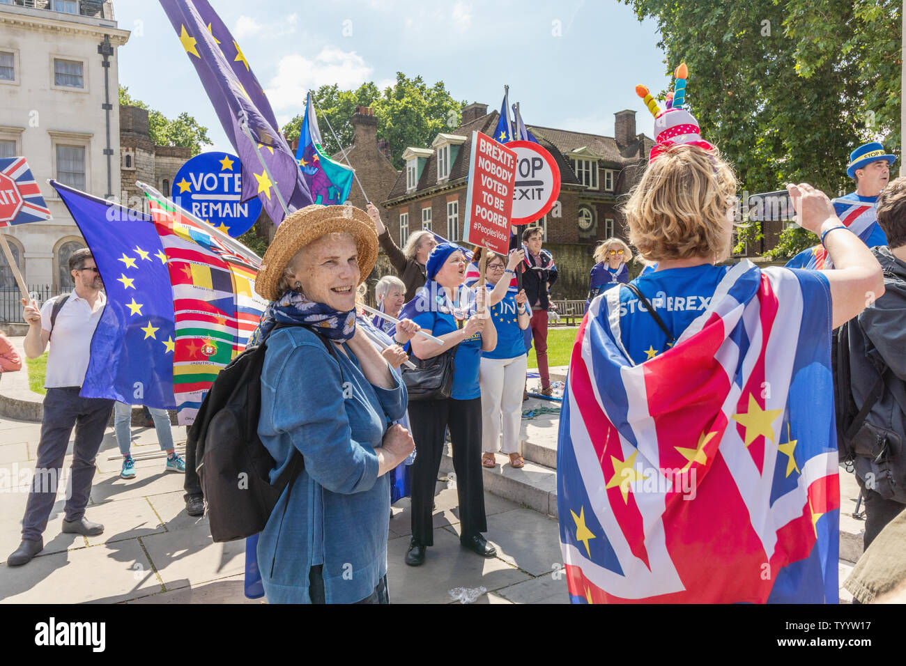 London / UK - June 26th 2019 - Pro-EU anti-Brexit protesters holding European Union flags and stop Brexit signs outside Parliament in Westminster - Stock Image