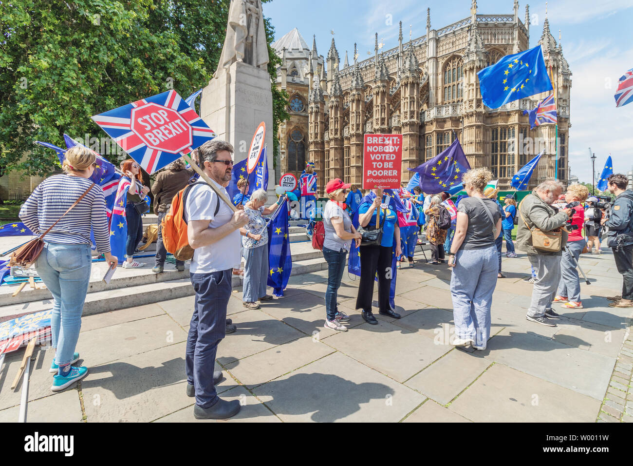 London / UK - June 26th 2019 - Pro-EU anti-Brexit protesters holding European Union flags and 'stop Brexit' signs opposite Parliament in Westminster - Stock Image