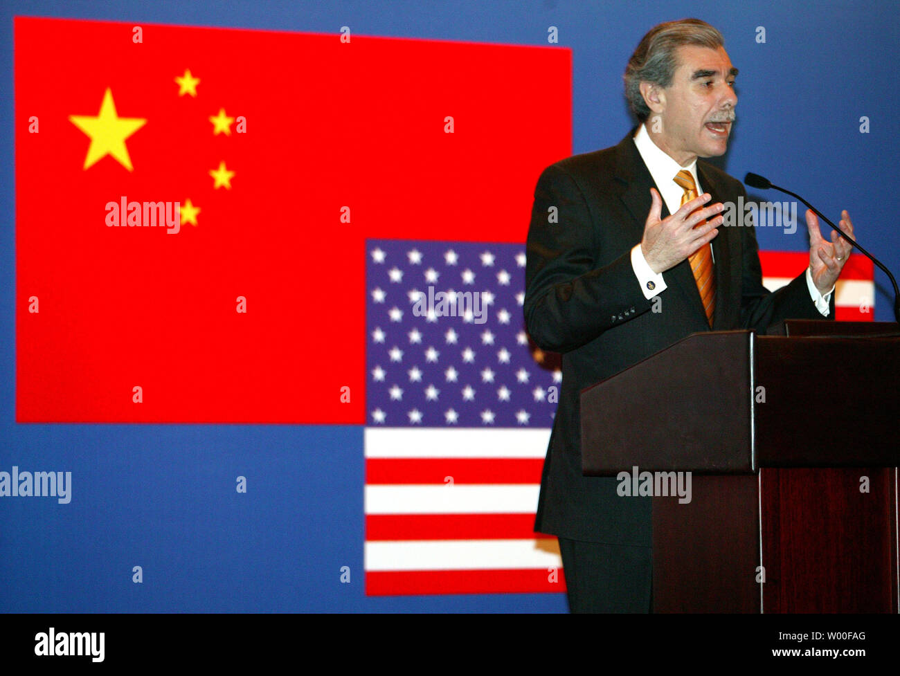 U.S. Commerce Secretary Carlos Gutierrez addresses a gathering of top U.S. and Chinese business executives at an Intellectual Property Rights Roundtable in Beijing, China,  November 14, 2006.  Gutierrez urged Beijing to toughen a crackdown on pirated goods and other copyright infringements, saying failure to do so could fuel an American backlash against trade with China.  (UPI Photo/Stephen Shaver) Stock Photo