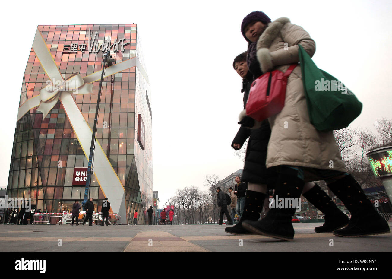 Chinese Shoppers Walk Past A New International Shopping Plaza