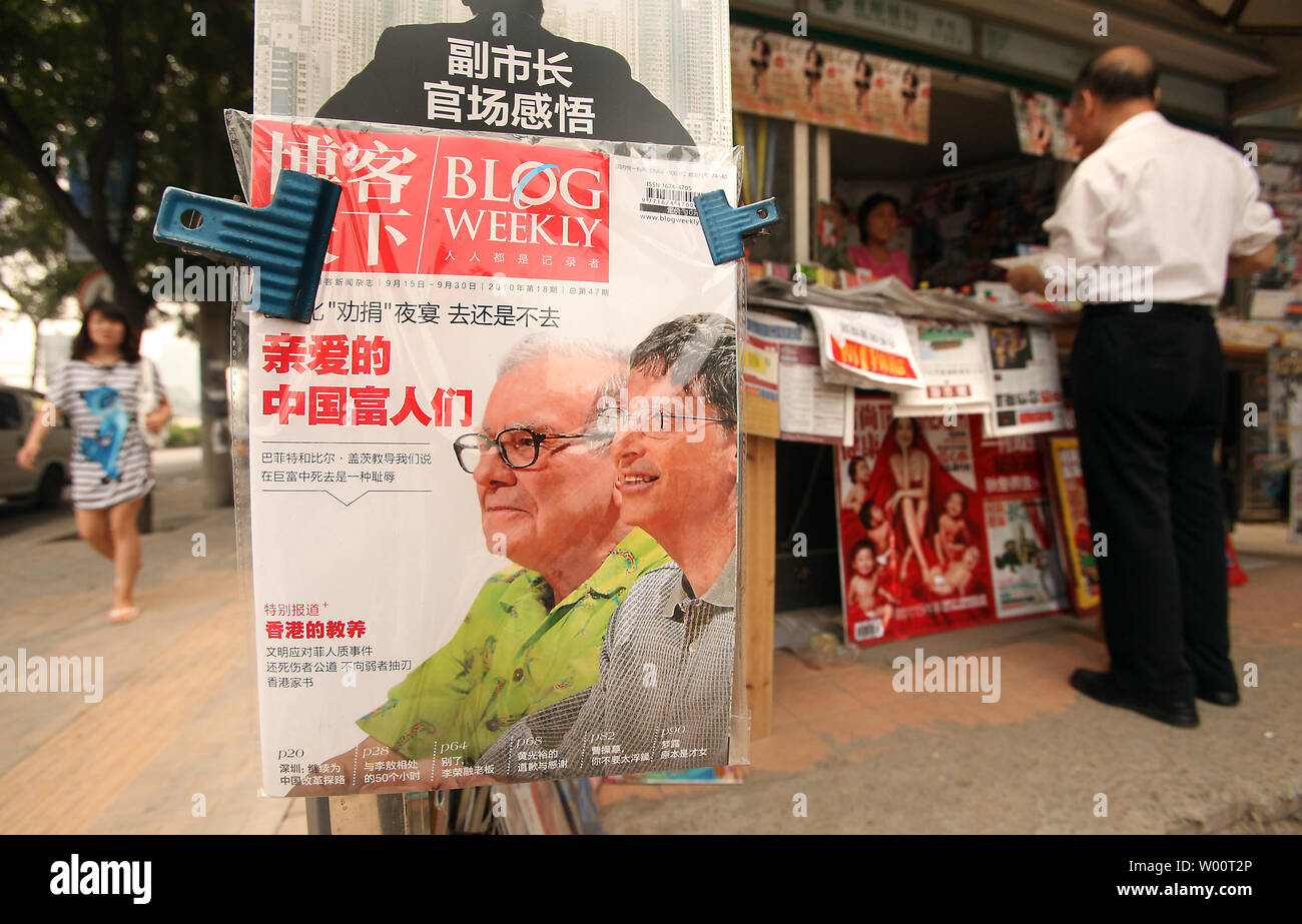 A popular Chinese magazine covering current events in China features a front page story on Warren Buffett and Bill Gates at a news stand in downtown Beijing September 20, 2010.  Both Buffett and Gates will visit Beijing this month in a drive to promote philanthropy among China's super-rich.    UPI/Stephen Shaver - Stock Image