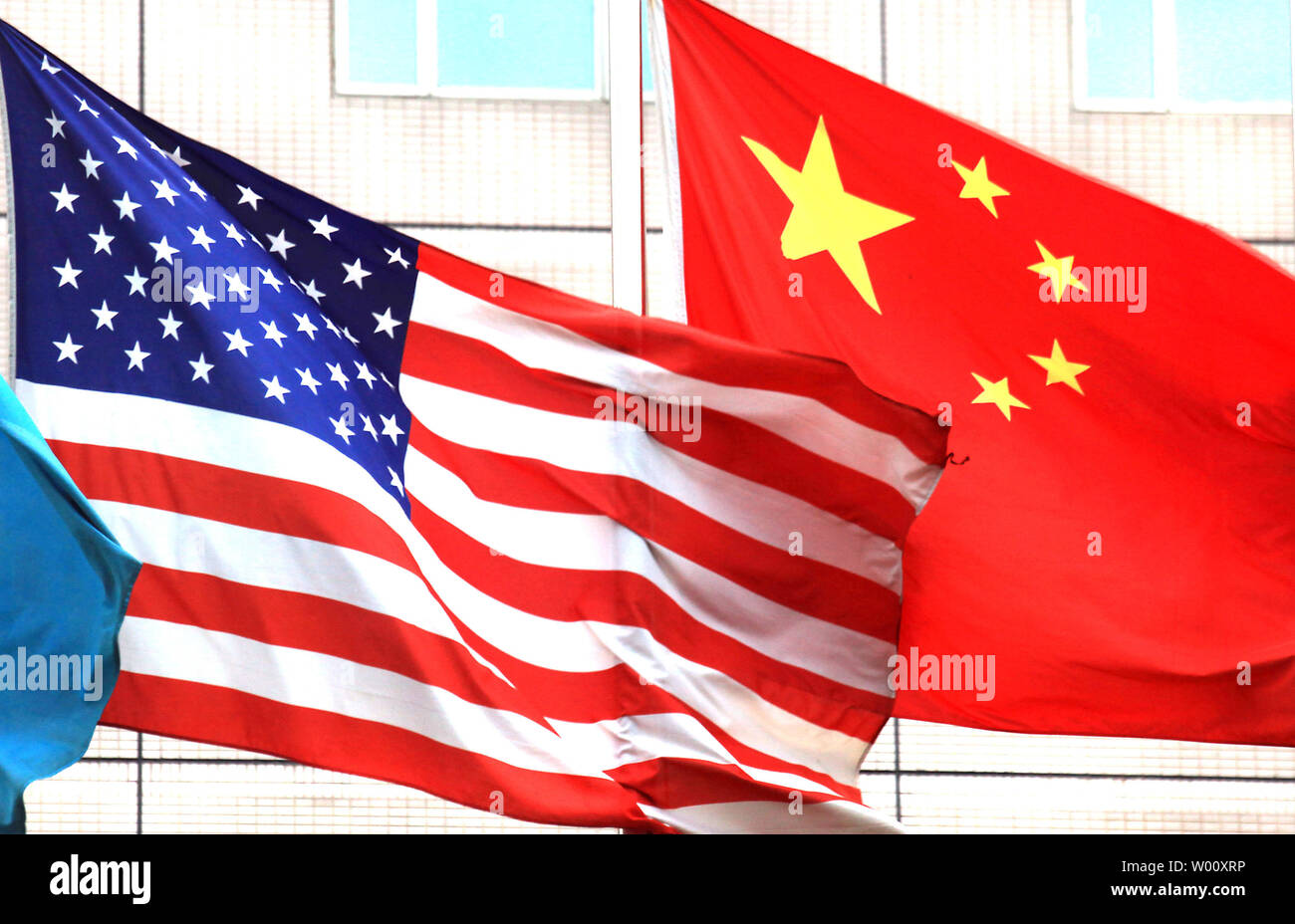 Both the American and Chinese national flags fly outside the hotel where U.S. Vice President Joe Biden will stay next week in Beijing on August 12, 2011.  Biden will visit China's capital in the wake of the country's pointed criticism of Washington's failure to solve its debt crisis.    UPI/Stephen Shaver Stock Photo