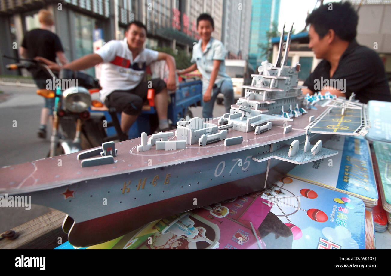 A Chinese man sells a cut-out model of what he insists is