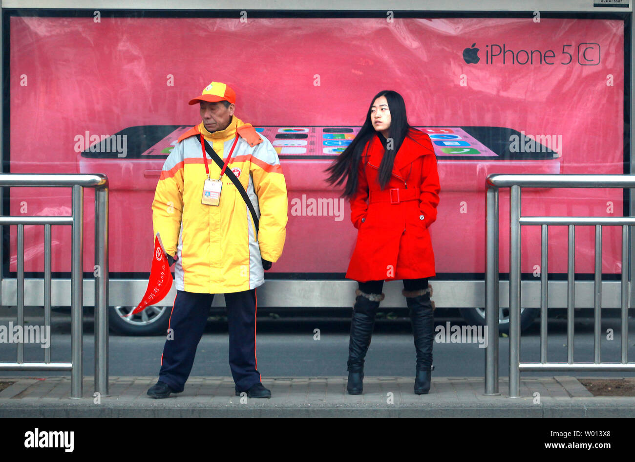 Apple's new iPhone 5C is promoted on the streets of Beijing on December 8, 2013.  China, the world's biggest smartphone market, had 1.2 billion mobile phone users as of the end of October.  Apple and China Mobile have reportedly inked a much-anticipated deal that should make buying an iPhone easier for hundreds of millions of Chinese.   UPI/Stephen Shaver Stock Photo