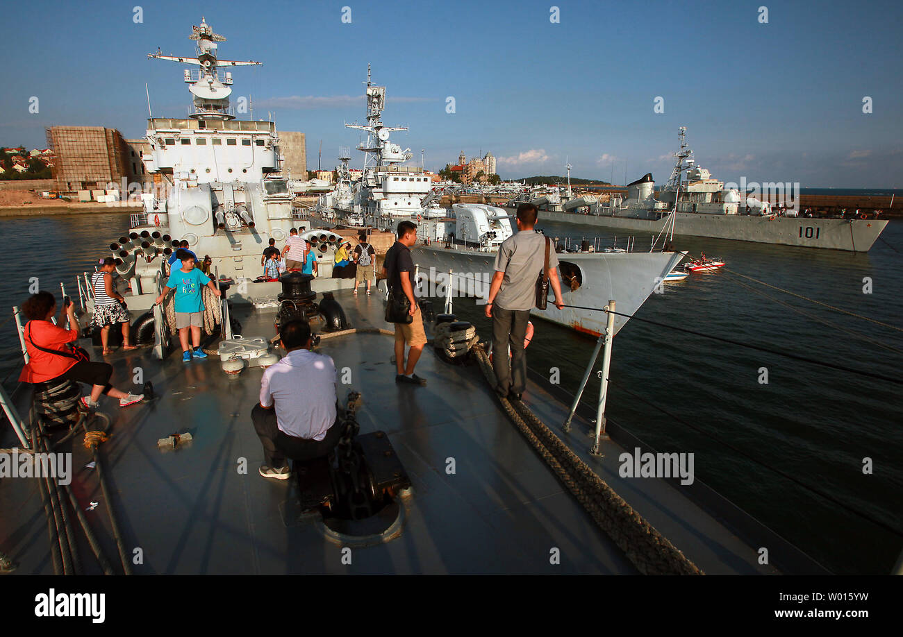 Chinese tourists visit the Qingdao Naval Museum, the only military museum that features the development of China's modern navy, in the coastal city Qingdao, a major port in eastern Shandong Province, on August 18, 2014.  The museum is home to a retired destroyer, guided missile frigates, a submarine and fighter jets.  China is modernizing its 'blue water' navy at an alarming pace according to the United States, which has America's Asian allies alarmed at the growing threat of naval confrontations with China regarding disputed territorial waters.      UPI/Stephen Shaver - Stock Image