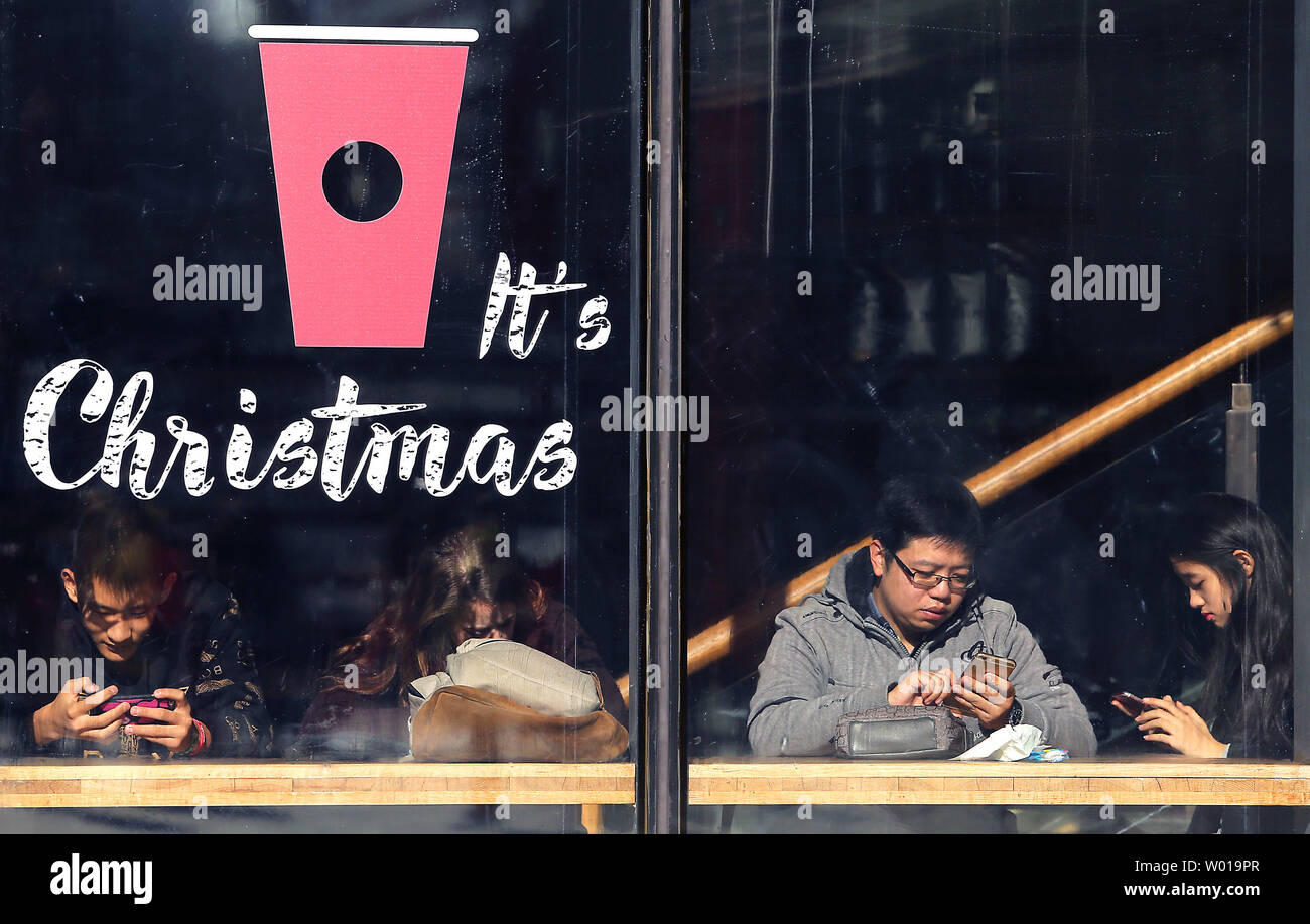 Chinese sit in a Starbuck's in downtown Beijing on December