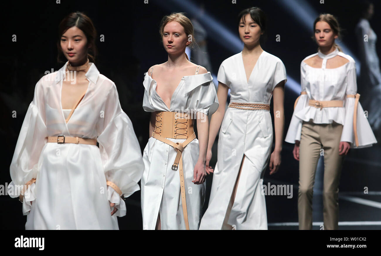 Models Showcase The Near White Collection By Chinese Fashion Designer Wang Xiaoshi During China Fashion Week Being Held In Beijing On March 30 2017 Chinese Fashion Designers Are Gaining Prominence In European