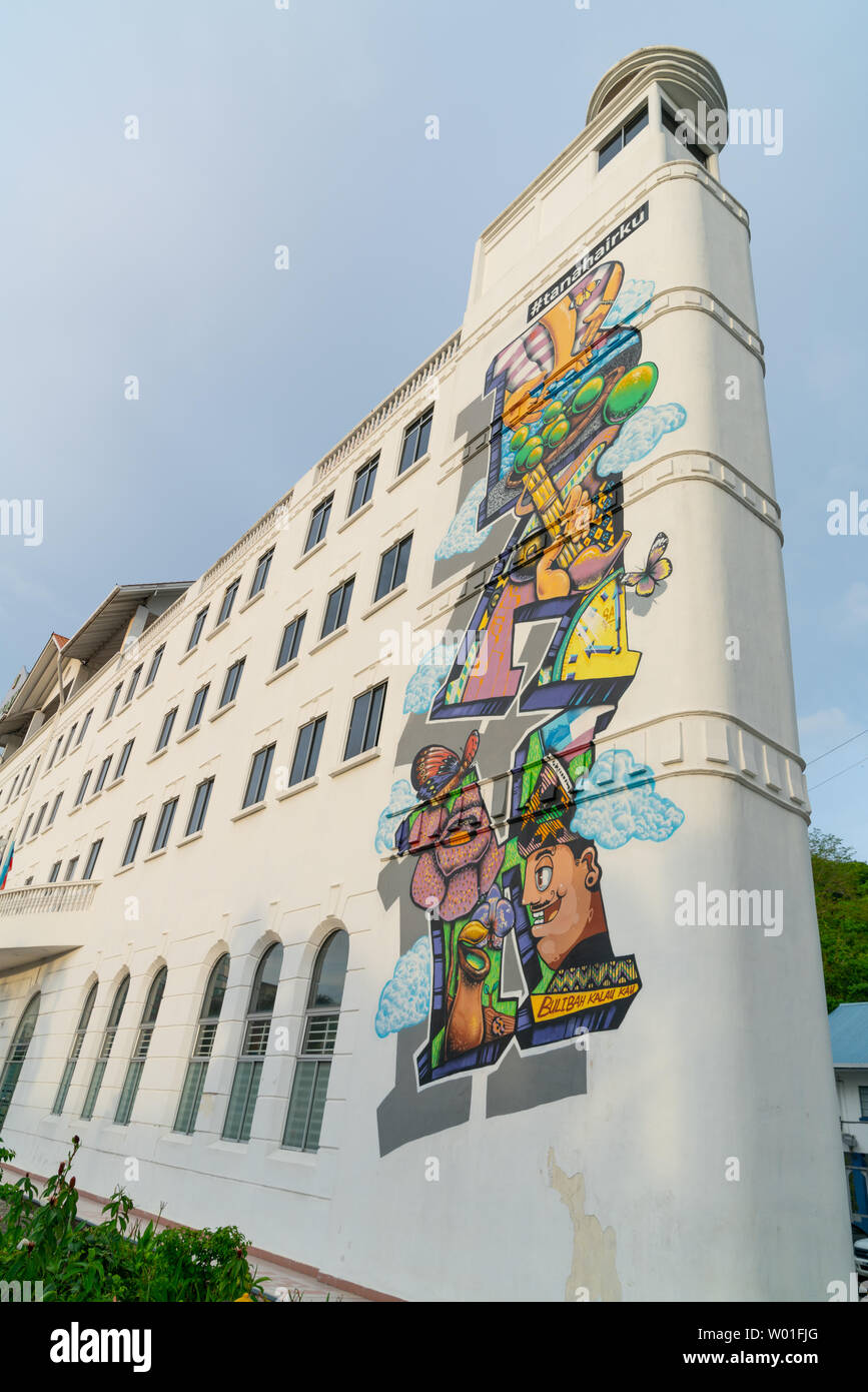 KOTA KINABALU BORNEO - MAY 31 2019; Street art on side of tall institional building by group of artists known as Cracko, Phey and Lybby in 2015 - Stock Image