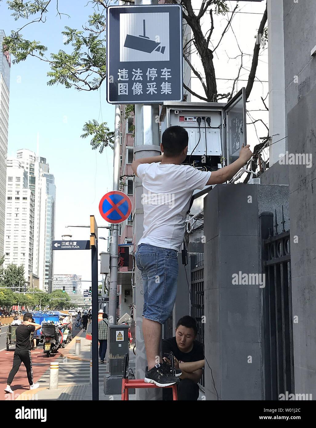 Chinese technicians install an additional surveillance