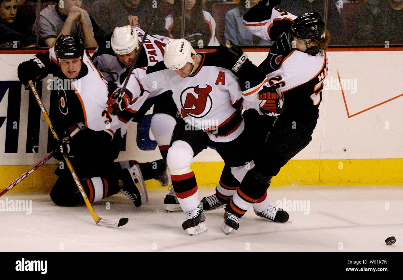 premium selection 2f054 fb55d The Flyers' Mattias Timander (3), Devils' Erik Rassumssen ...