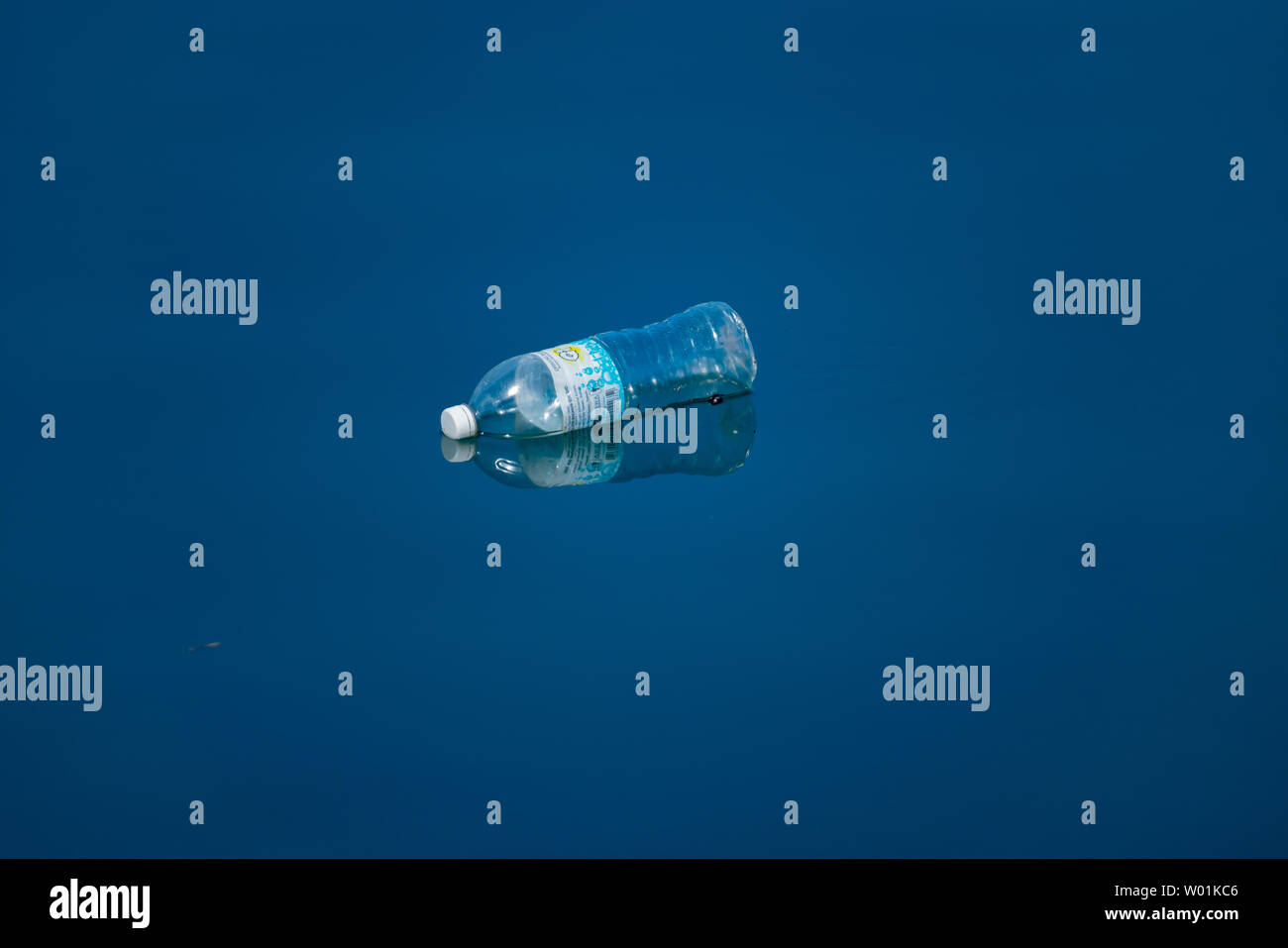 LAHAD DATU MALAYSIA - MAY 17 2019; Sea trash, environmental hazard of one plastic bottle carelessly thrown in the water - Stock Image