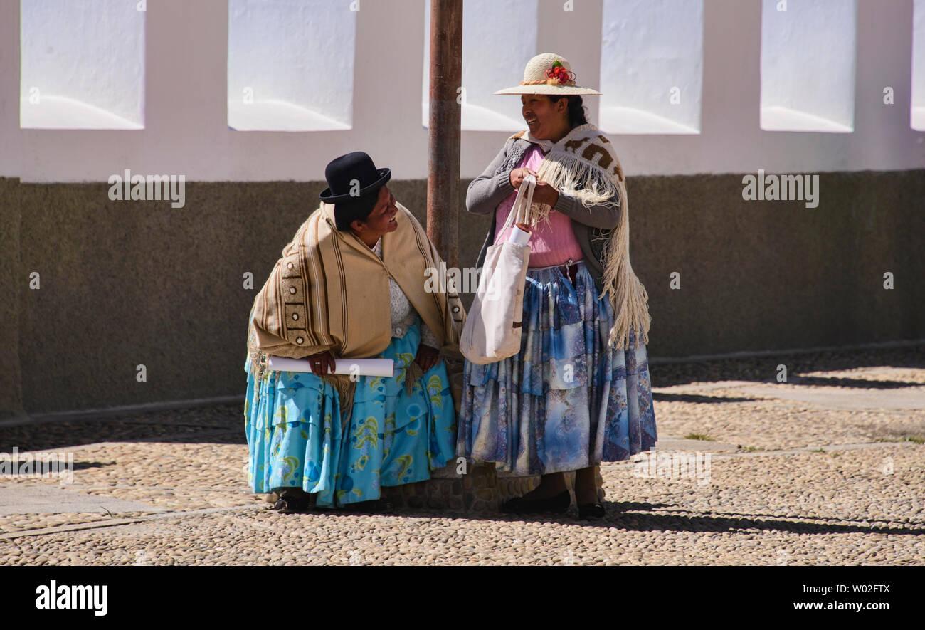 Cholitas at the Basílica de Nuestra Señora church in Copacabana, Bolivia Stock Photo