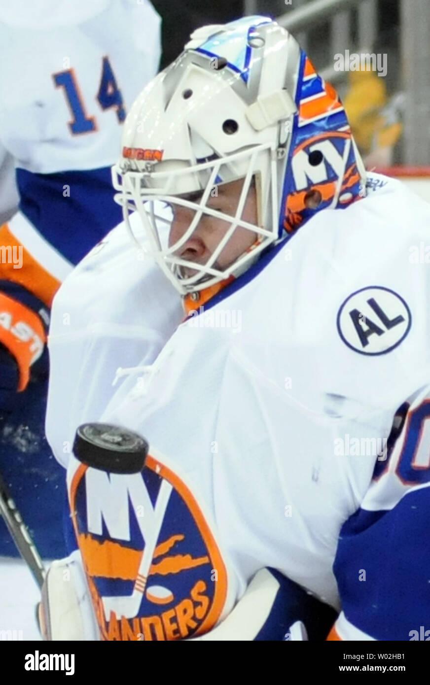 purchase cheap 9b5e2 f92d2 New York Islanders goalie Jean-Francois Berube (30) watches ...