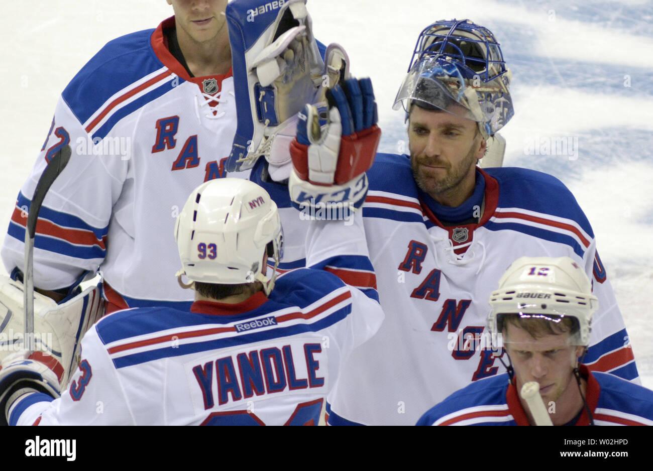 outlet store a2b1a 9df52 New York Rangers goalie Henrik Lundqvist (30) high-fives New ...