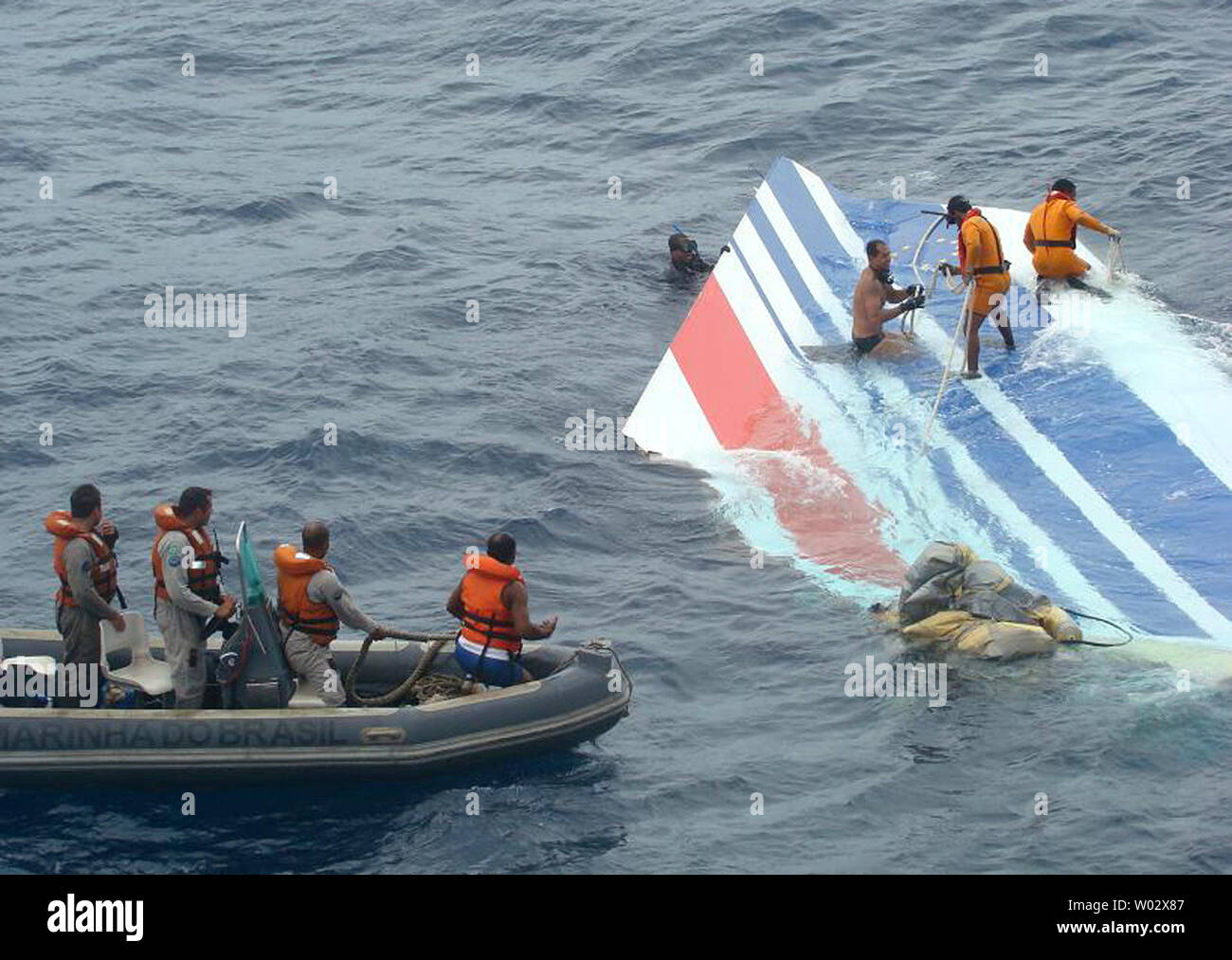 In this photo released by the Brazilian Air Force members of Brazil's Navy recover debris from the missing Air France jet in the Atlantic Ocean, June 8, 2009. The U.S. Navy is sending a team equipped with underwater listening devices to assist in the search for the missing black box. UPI/Brazilian Air Force - Stock Image