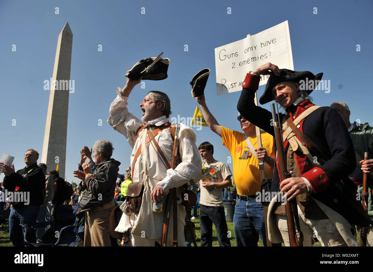 People dressed as Minutemen from the Revolutionary War attend a second amendment rally on the grounds of the Washington Monument, in Washington on April 19, 2010. Pro-gun rallies where held around the country today, also known as Patriots' Day, the anniversary of the American Revolutionary War battles of Lexington and Concord and the Oklahoma City bombing.    UPI/Kevin Dietsch Stock Photo
