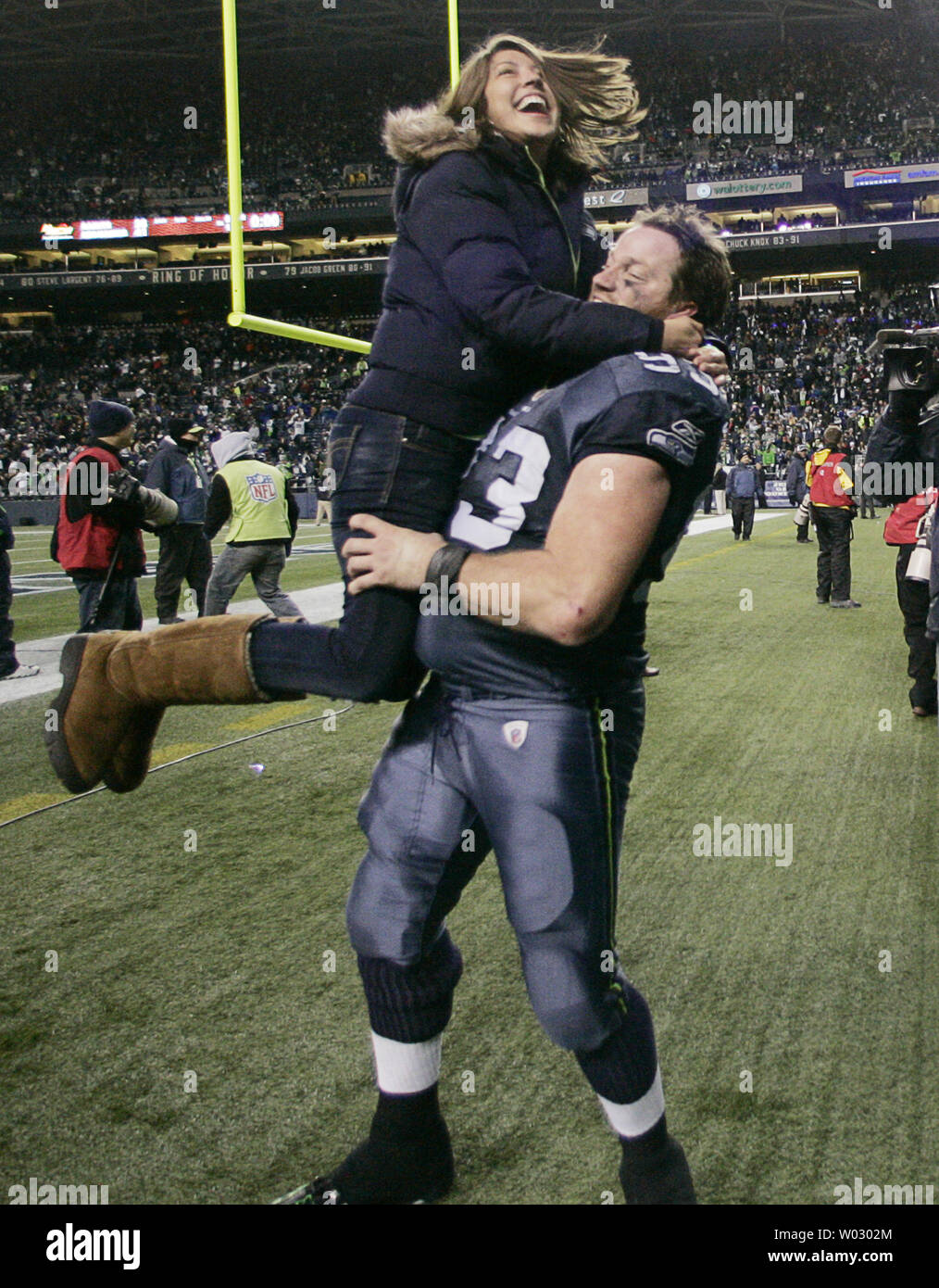 Seattle Seahawks defensive tackle Craig Terrill celebrates with his wife after their 41-36 win over the defending Super Bowl Champion New Orleans Saints in the NFC's wild-card playoff game on Saturday January 8, 2011 at Qwest Field in Seattle.    (UPI /Jim Bryant) Stock Photo