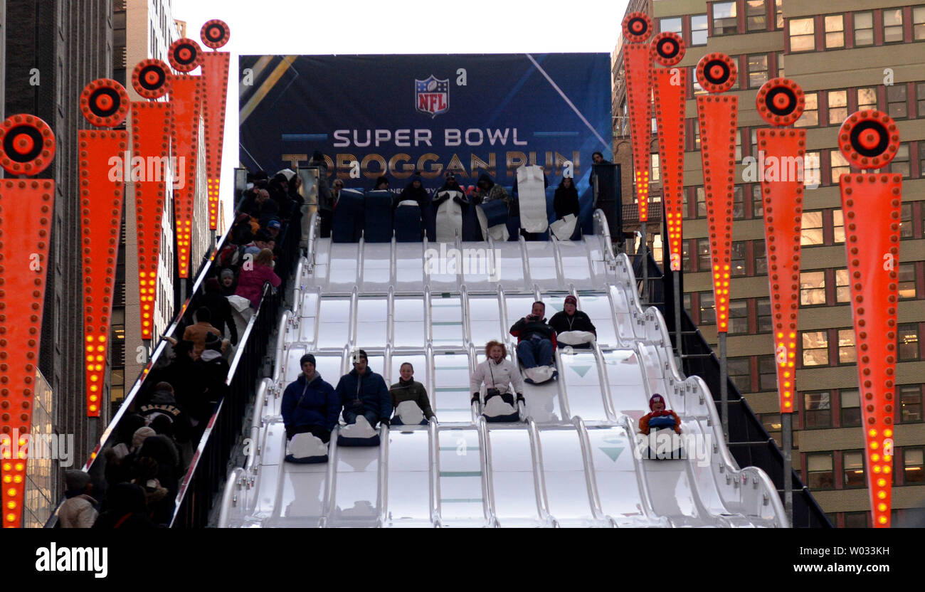 Fans get a chance on the Super Bowl toboggan run near Times Square at the NFL Super Bowl Boulevard Fan Experience that takes up 13 blocks of Broadway in downtown Manhattan, New York on Wednesday, January 30, 2014.  Super Bowl XLVIII fans from the Denver Broncos and Seattle Seahawks fill the streets as they get read for the game on Sunday, February 2, 2014.  UPI/Pat Benic - Stock Image