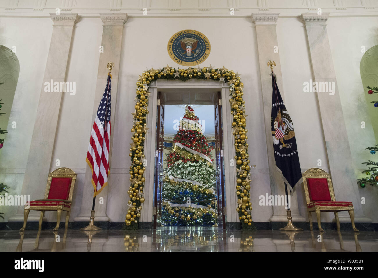 Decorations are seen in the Cross Hall during a holiday tour at the White House in Washington, D.C. on December 2, 2015. This year's team is 'A Timeless Tradition, and reflects long-held traditions cherished across America and commemorates extradorinaiy moments that help shaped the county. Photo by Kevin Dietsch/UPI - Stock Image