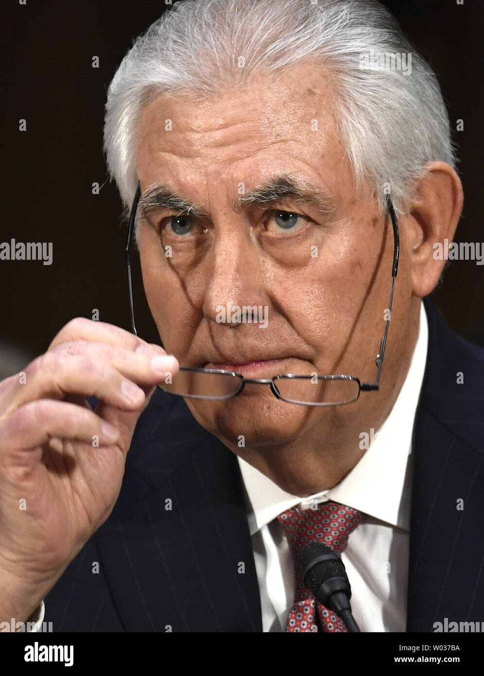 Former ExxonMobil CEO Rex Tillerson, nominated for secretary of state, removes his glasses after making his opening statement during Senate Foreign Relations Committee confirmation hearings, on Capitol Hill, January 11, 2017, in Washington, D.C. Tillerson's close business relationship with Russia is expected to be scrutinized by the panel. Photo by Mike Theiler/UPI - Stock Image