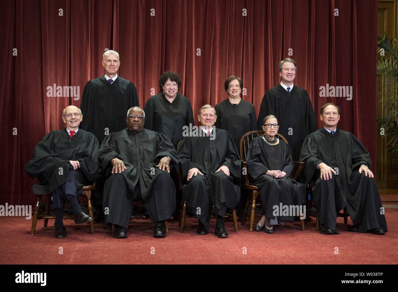 The Supreme Court Justices pose for their official group portrait in the Supreme Court on November 30, 2018 in Washington, D.C. Seated from left: Associate Justice Stephen Breyer, Associate Justice Clarence Thomas, Chief Justice John G. Roberts, Associate Justice Ruth Bader Ginsburg and Associate Justice Samuel Alito, Jr. Standing behind from left: Associate Justice Neil Gorsuch, Associate Justice Sonia Sotomayor, Associate Justice Elena Kagan and Associate Justice Brett M. Kavanaugh. Photo by Kevin Dietsch/UPI - Stock Image