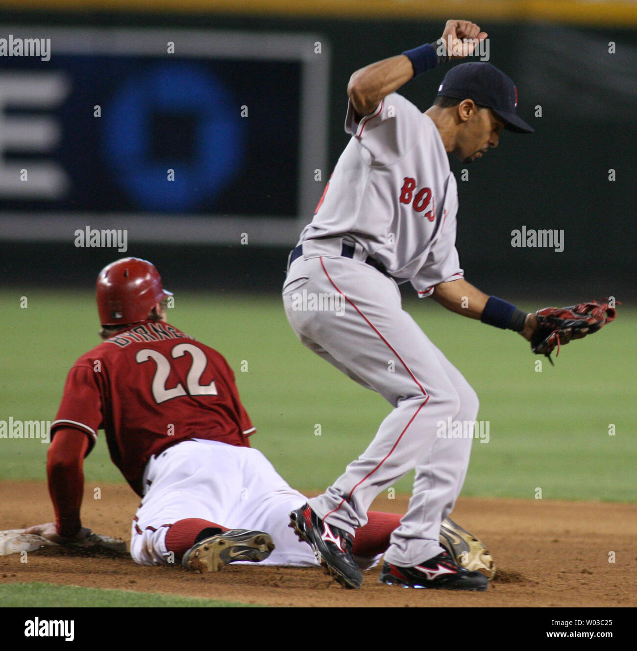 Diamondbacks Eric Byrnes (22) looks to centerfield as Red Sox shortstop Julio Lugo (right) comes down without the ball during the the fifth inning against the Boston Red Sox at Chase Field in Phoenix on June 10,2007.  The ball went into centerfield and Byrnes advanced to third base on the play. (UPI Photo/Art Foxall) Stock Photo