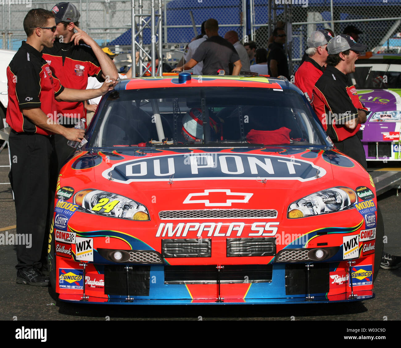 The Pit Crew For Jeff Gordon Wait By Gordon S Car During Inspection