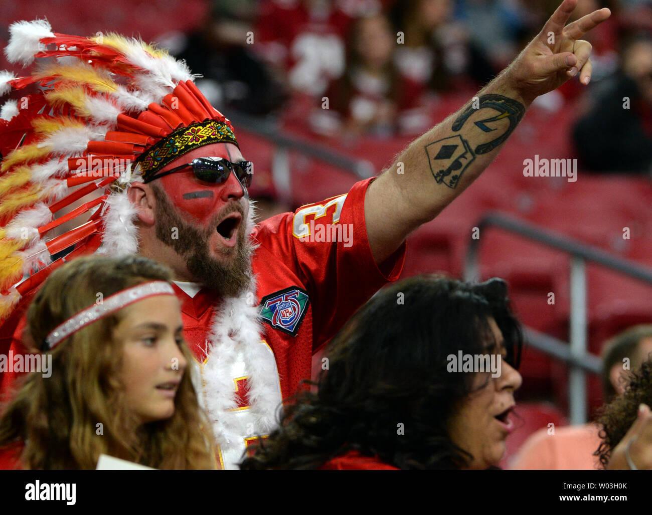on sale 61c85 a4f84 A Kansas City Chiefs fan wearing a head dress tries to get ...