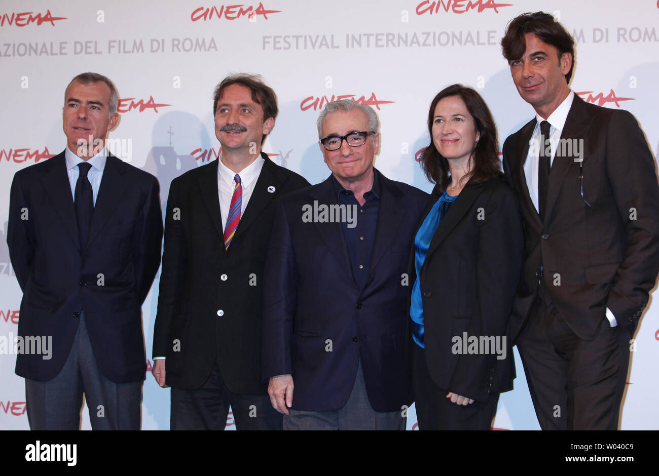 Martin Scorsese (C) and a delegation from the film 'La Dolce Vita' arrive at a photocall during the 5th Rome International Film Festival in Rome on October 30, 2010.  Scorsese was in Rome to officially present a digitally restored version of the 1960 classic film.   UPI/David Silpa - Stock Image