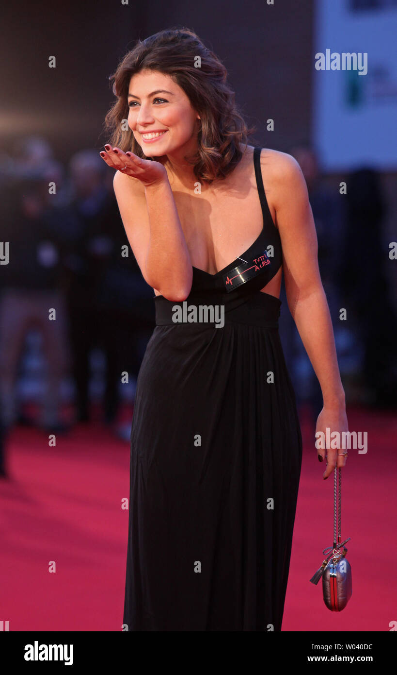 Alessandra Mastronardi arrives on the red carpet before the screening of a digitally restored version of the 1960 classic film 'La Dolce Vita' during the 5th Rome International Film Festival in Rome on October 30, 2010.   UPI/David Silpa - Stock Image