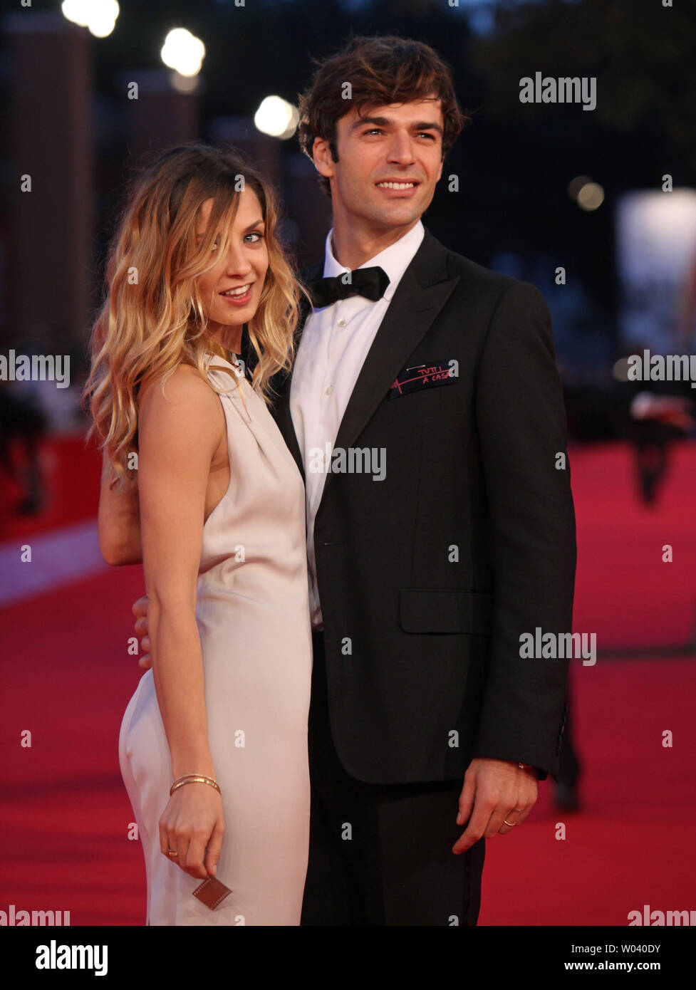 Myriam Catania (L) and Luca Argentero arrive on the red carpet before the screening of a digitally restored version of the 1960 classic film 'La Dolce Vita' during the 5th Rome International Film Festival in Rome on October 30, 2010.   UPI/David Silpa - Stock Image